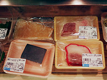 Various cuts of whale meat for sale.