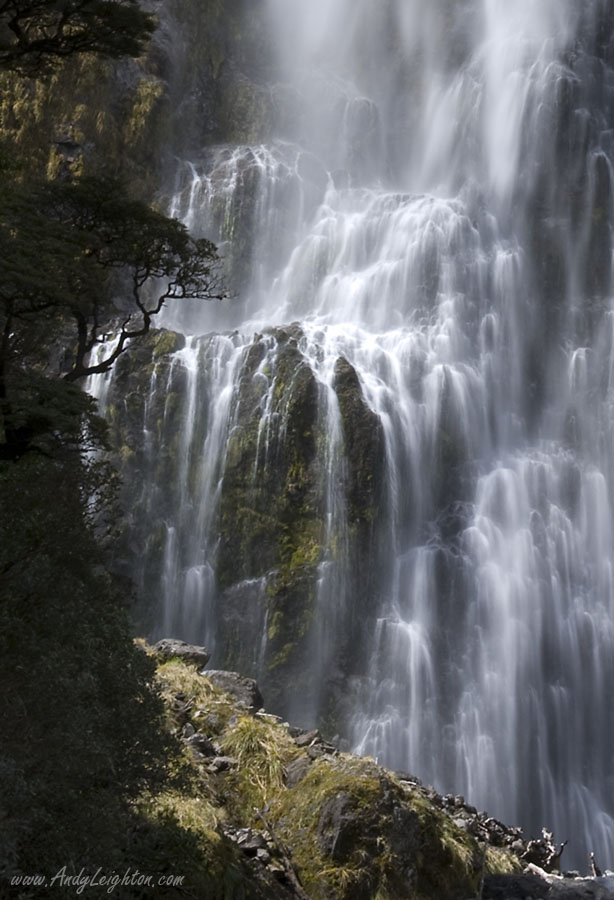 Flowing silky white water of the Devils Punchbowl Waterfall in Arthurs Pass National Park, New Zealand