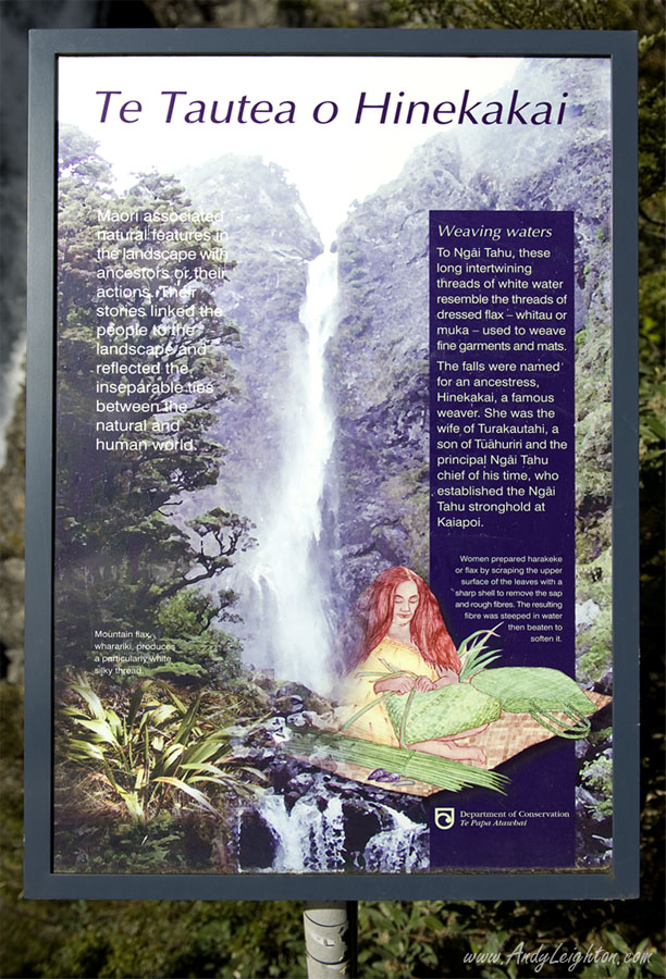 A sign at the bottom of the falls describes the native Maori connection with the Devils Punchbowl Waterfall. Arthurs Pass National Park, New Zealand
