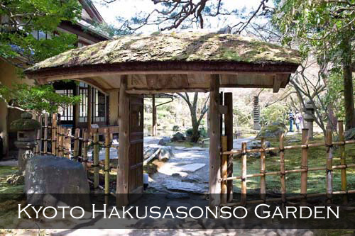 A wooden gateway and bamboo fence with a stone path. Hakusasonso Garden, Kyoto, Japan