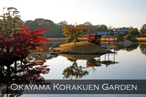 Still ponds, beautiful Japanese Maple autumn colours and landscape scenery in the Korakuen Garden. Okayama, Japan