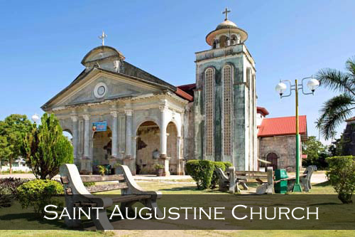 Saint Augustine Church with an old concrete and wood bench in the foreground. Panglao Island, Philippines