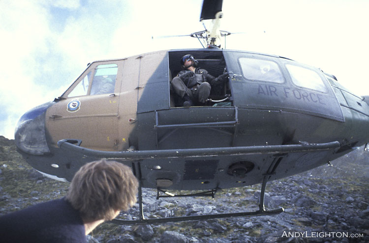 An Air Force Iroquois takes off after dropping searchers on the side of a mountain, after exiting the helicopter in steep terrain its often best just to drop to the ground below the helicopter and wait until its clear before moving away from the landing area. Waitaha River Valley, Westland, New Zealand