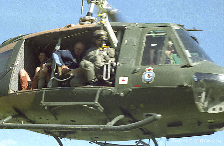 An Iroquois lifting off, ferrying searchers to the next search area. Kopara, Westland, New Zealand. Jim Macintosh