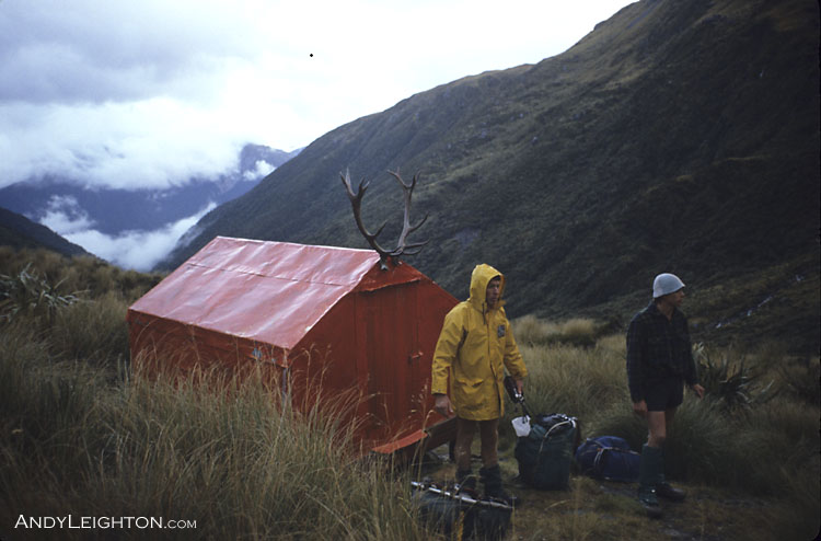 Two searchers packed and ready to go outside Scottys Biv at the headwaters of Scottys Creek in the Taipo River Valley, because of its remote location the hut logbook was recording less than 10 visits a year since 2005. The hut was built in the early 1960's by Allan Farmer from Rotorua. Allan Farmer wrote a book 'The best Job Ever' about his NZ Forest Service exploits and Scottys Biv gets a mention in that book. Tara Tama, Taipo, Westland, New Zealand. Barry Petrie, Mark Sims