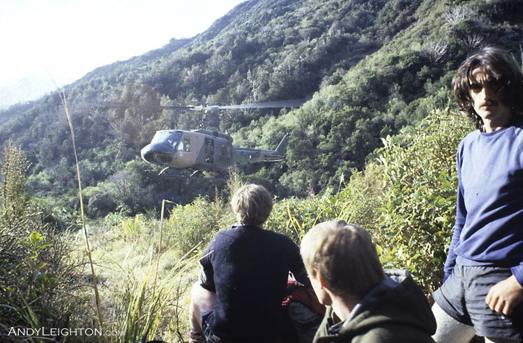 An Air Force Iroquois helicopter slowly works it way into a tight landing spot to pick up searchers. Taipo River Valley, Westland, New Zealand. Bob Bird, Stephen Langridge, unknown