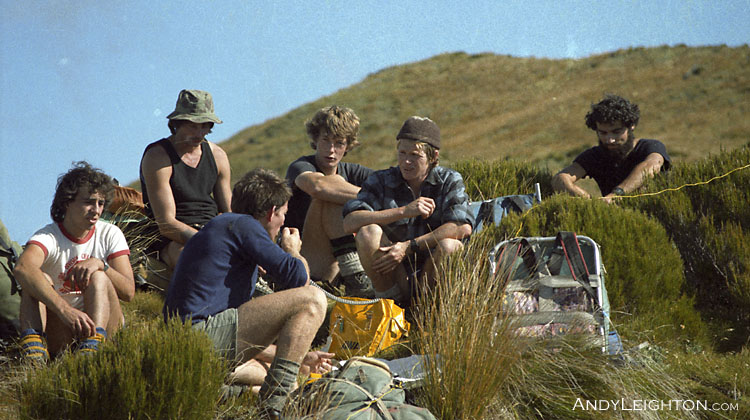 A radio schedule back to base from high on the Lake Morgan tops. Westland, New Zealand. Kevin Cowan, Phil Van Lue, Barry Petrie, Murray Wright, Kenny Sims, unknown