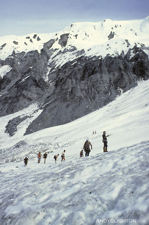 Searchers spread out over the snow and ice looking for any signs of the missing hiker. Waitaha River Valley, Westland, New Zealand