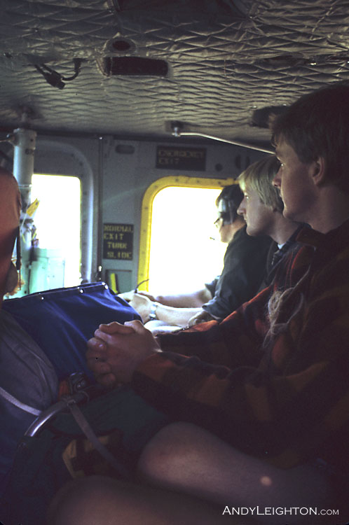 Inside the Airforce Iroquois, three searchers are ferried to the next search area. Westland, New Zealand. Bob Bird, Garry turnbull, Stephen Langridge.
