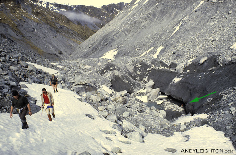 Searches walk up along the valley floor. On the right of the photo in the river bed can be seen a large hole gouged out by flood waters, for scale there is a searcher barely visible standing at the bottom of the hole looking for any signs of the missing hiker. Waitaha River Valley, Westland, New Zealand. Stephen Langridge, unknown, Garry Turnbull