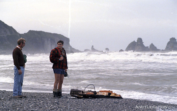Searching along the coast looking for three fisherman lost during a raging Westland Storm. Here we found part of the destroyed fishing boat washed up on the shore. North of Greymouth, Westland, New Zealand. unknown, Alan Hendrickson