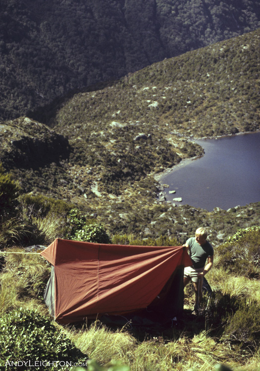 Pitching the tent on the most flat piece of ground we could find, with Lake Ruby in the Background. Hohonu Ranges, Westland, New Zealand. Garry Turnbull