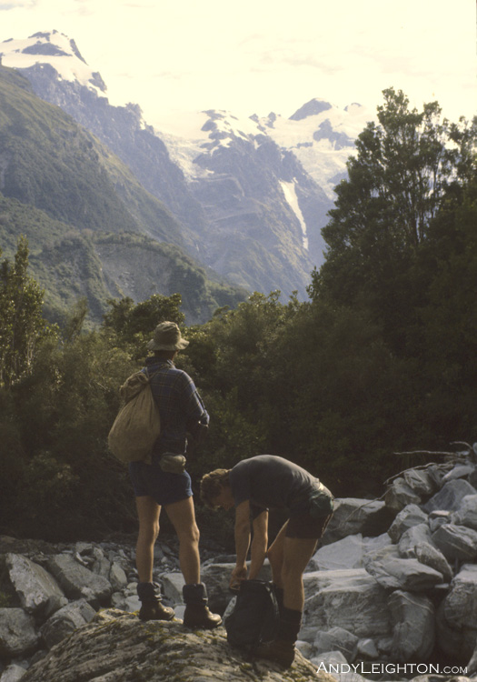 At the confluence of the Perth River and Prospectors Creek, steep mountainous country in the background can be seen where we had been hunting days before. Westland, New Zealand. Mick Delury, Andy Leighton