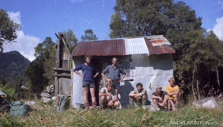 A bunch of Likely Lads outside Nolans Hut, ready for their next daring mission. Perth River Valley, Westland, New Zealand. Joe, Andy Leighton, Mick Delury, Ian Arnott, Garry Turnbull, Malcolm Thomas