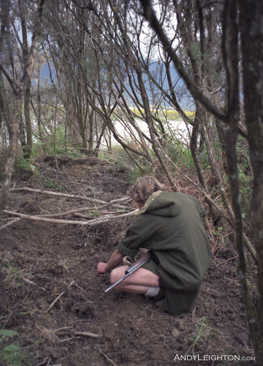 Checking fresh sign of wild pig rooting under the river bank gorse bushes. Ahaura River, Andy Leighton