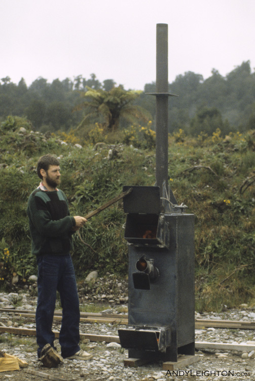 Gary Ralfe giving a newly built firebox its first light up after being built. Gary designed and fabricated the firebox, it was later put into a kiln where my sphagnum moss was dried. Marsden, Westland, New Zealand