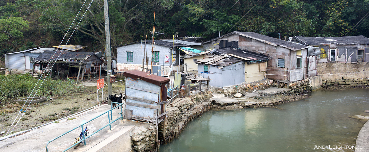 HDR picture of derelict old sheds beside a small river in Tai O, Lantau Island, Hong Kong