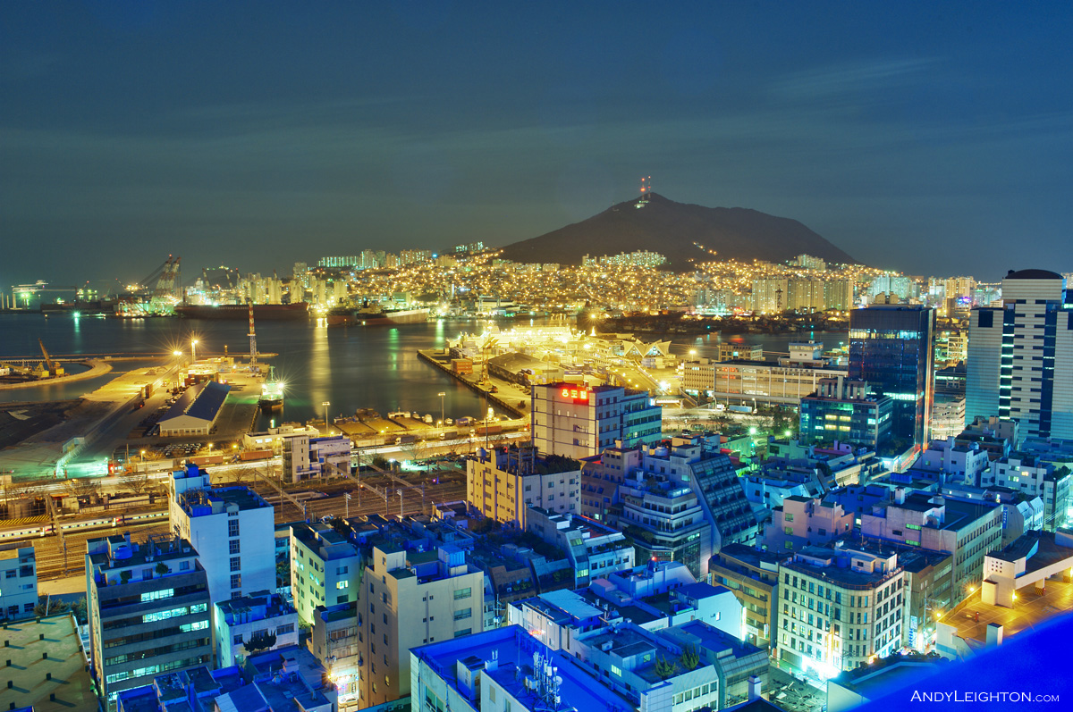 HDR photograph of Busan Harbour at night time taken from the city's rooftops. South Korea
