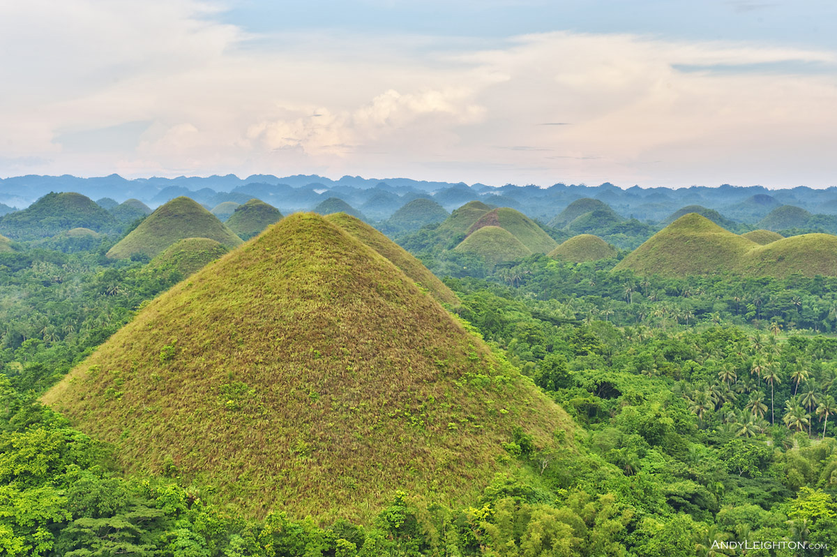 HDR picture of the Chocolate Hills, they are in Bohol Province, Philippines, there are around 1,770 hills spread over an area of more than 50 square kilometres. They are covered in a green grass that turns brown during the dry season, giving them their name 'The Chocolate Hills'