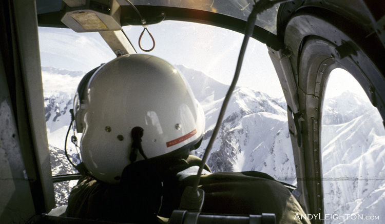 Looking through the helicopter cockpit of a Hughes 500 at the snowy Fiordland mountains, Te Anau, New Zealand. ZK-HKL, Rod Hall Jones (instructor)