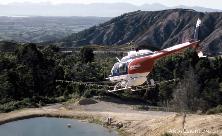 Spraying herbicide from a Bell JetRanger helicopter in the Nelson pine forests, New Zealand. HSG, Kevin Anderson (pilot)