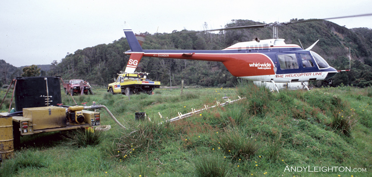 Pumping herbicide into the helicopter belly tank, Karamea, New Zealand. HSG