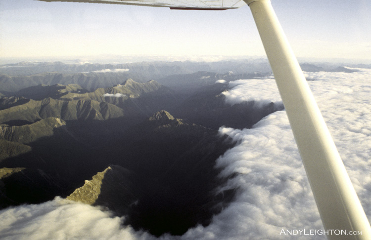 Westerly cloud building over the Tasman Mountains in the Kahurangi National Park, New Zealand. EHO, Andy Leighton (pilot)