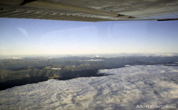 A blanket of westerly cloud building over the Tasman Mountains in the Kahurangi National Park, New Zealand. EHO, Andy Leighton (pilot)